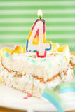 Slice of fourth birthday cake Stock Photos