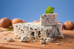 Slice of French Roquefort cheese. Royalty Free Stock Photo