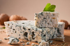Slice of French Roquefort cheese. Royalty Free Stock Image