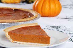 Slice of fresh baked pumpkin pie Royalty Free Stock Photos