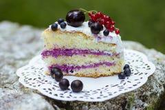 Slice of fresh berry cake. On lace doily stock photos