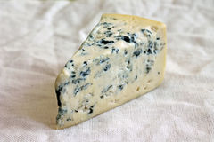 Slice of fresh blue cheese Stock Images