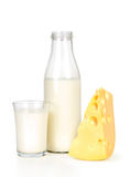Slice of fresh cheese and milk bottle with glass Royalty Free Stock Photo