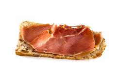 Slice of fresh homemade Alpine Baguette with jamon isolated over Royalty Free Stock Photography