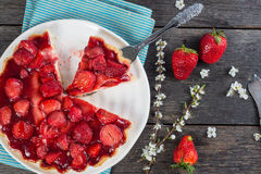 Slice of fresh homemade strawberry tart with flowers from above Stock Photos