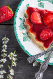 Slice of fresh homemade strawberry tart with flowers from above Royalty Free Stock Photo