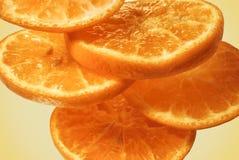 Slice fresh juicy orange close-up bright saturated orange fruit isolated white background.  Stock Photo