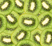 Slice of fresh kiwi fruit background Stock Photo