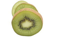Slice of fresh kiwi fruit isolated on white Stock Photography