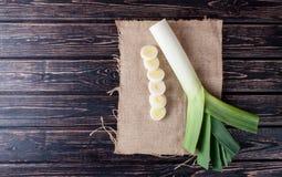 Fresh leek on wood. Slice fresh leek on wood desk. Food ingredients royalty free stock images