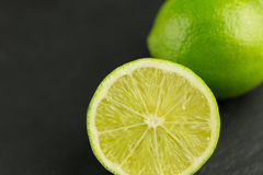 Slice of fresh lime fruit. Healthy lime fruits on dark background Stock Image