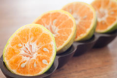 Slice of fresh orange in wooden tray Stock Photography