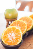 Slice of fresh orange in wooden tray Royalty Free Stock Photography