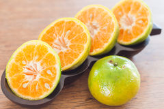 Slice of fresh orange in wooden tray Royalty Free Stock Image