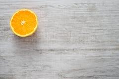 Slice of fresh oranges on white wood background Stock Image