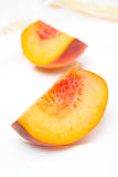 Slice of fresh peach on a plate, close-up Royalty Free Stock Photography