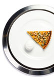 Slice of fresh Pumpkin Pie with whipped cream and pumpkin seeds Stock Photography