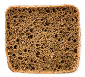 Slice of fresh wholemeal rye bread on a white Royalty Free Stock Image