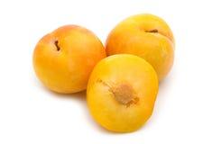 Slice fresh yellow plum. On white background Royalty Free Stock Photography