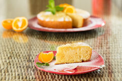 Slice of freshly cooked orange cake on red plate Stock Photography