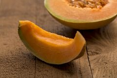 Slice of freshly cut muskmelon stock photos