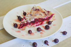 Slice of friut pie with cherries and jamberries Stock Photos
