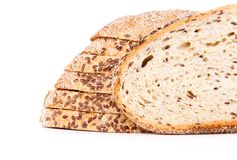 Slice in front of half loaf Royalty Free Stock Photo