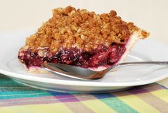 Slice fruit berry crumble pie with spoon Stock Images