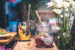 Slice Fruit in Clear Glass Jar Above Brown Wooden Table royalty free stock photography