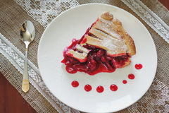Slice of fruit pie with cherries Royalty Free Stock Photo