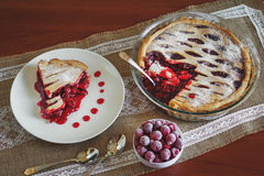 Slice of fruit pie with cherries. In white plate stock photo