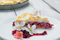 Slice of Fruit Pie with Flowers and Currant-Blueberry Jam Royalty Free Stock Image