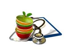 Slice fruits and stethoscope Royalty Free Stock Image