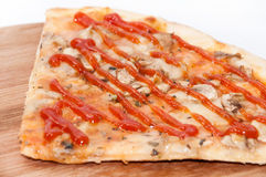 Slice of funghi pizza with tomato ketchup on it Royalty Free Stock Images