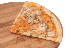 Slice of funghi pizza on the wooden board Stock Images