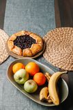 Slice of galette on a plate with tea. Homemade baking royalty free stock images
