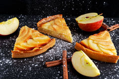 Slice of Golden Bramley apple tart with cinnamon glaze Stock Photos