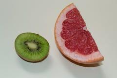 slice-of-grapefruit-and-half-of-kiwi Stock Photo