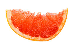Slice of grapefruit isolated on white Stock Photos