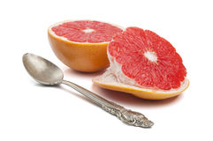 Slice of grapefruit isolated on white Royalty Free Stock Images