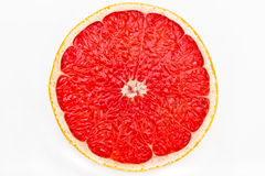 Slice of grapefruit isolated on white background with clipping path Royalty Free Stock Photo