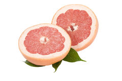 Slice Grapefruit with leaves on a white background Stock Photos