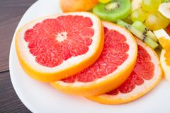 Slice of grapefruit on a palte Royalty Free Stock Image