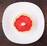 Slice of grapefruit on a palte Royalty Free Stock Photo