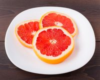 Slice of grapefruit on a palte Royalty Free Stock Photos