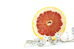 Slice of grapefruit with tape measure Stock Image