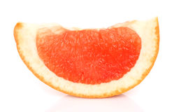 Slice of grapefruit on a white background. Close-up Royalty Free Stock Photo
