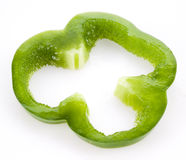 Slice of green bell pepper isolated on white Stock Images