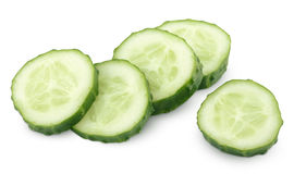 Slice of green cucumber isolated on white Stock Photography