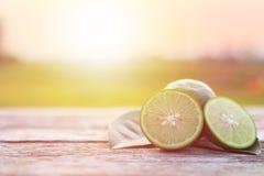 Slice green fresh lemon on wooden table background Stock Images